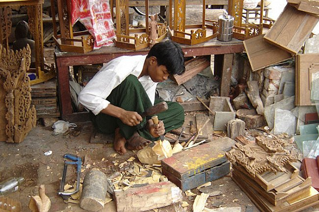 A woodcarver in his workshop