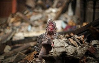 Antique statue in the rubble after 25th April 2015 earthquake in Nepal