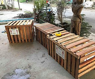 Crates with Buddha statues