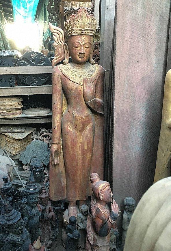 standing buddha statue