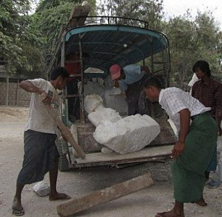Loading a marble Buddha statue