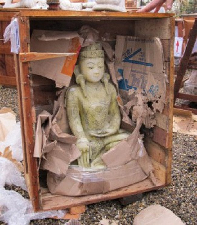 Marble Buddha, still in the crate