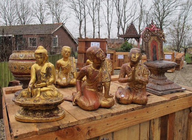 A group of Buddhas, just out of the crates