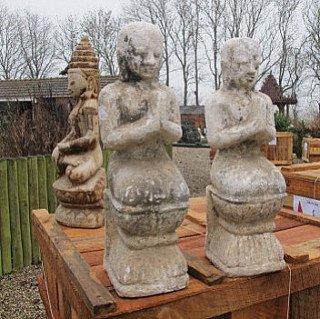Pair of antique sandstone monks