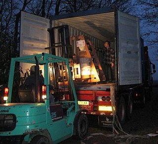 Unloading Buddha statues at night