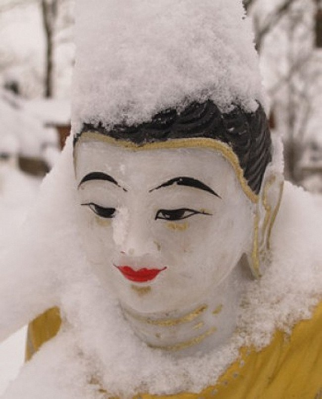 Buddha statue with snow