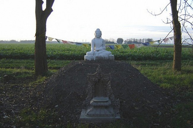 A marble Buddha in a beautiful place
