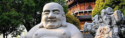 Where to place your laughing Buddha statue in your room?