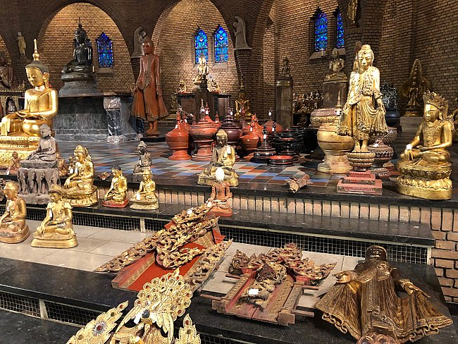 Many antique Buddha statues in church