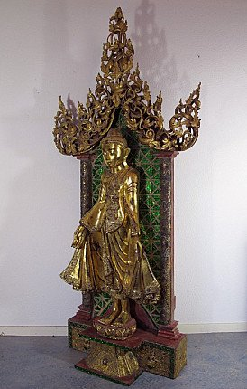 Antique Mandalay Buddha on throne