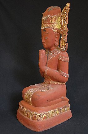 Antique crowned monk statue