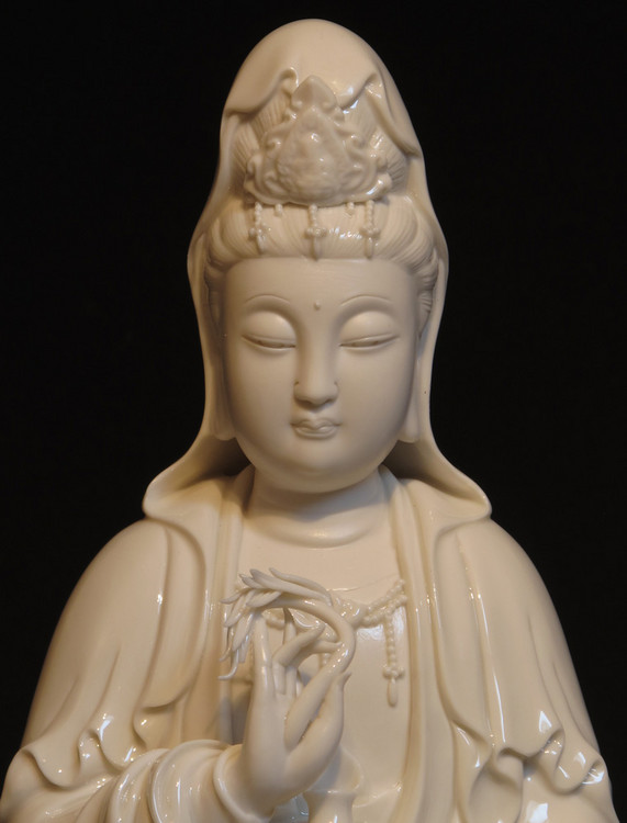 New sitting Guan Yin from China made from porcelain