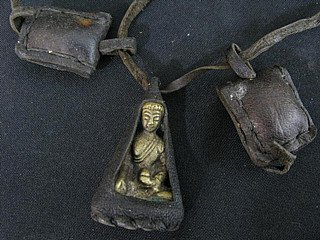 Buddha neckless with bronze hanger in leather bag