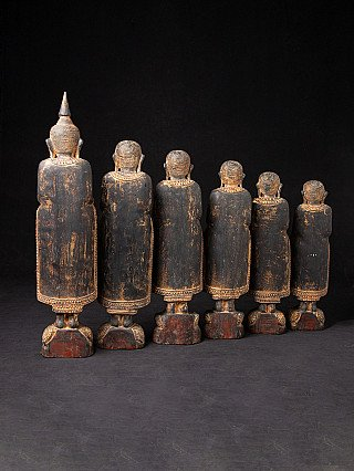 Old Buddha with 5 following monk statues