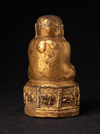 Old Buddha statue without a face