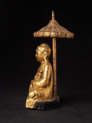 Antique Burmese Buddha statue with umbrella