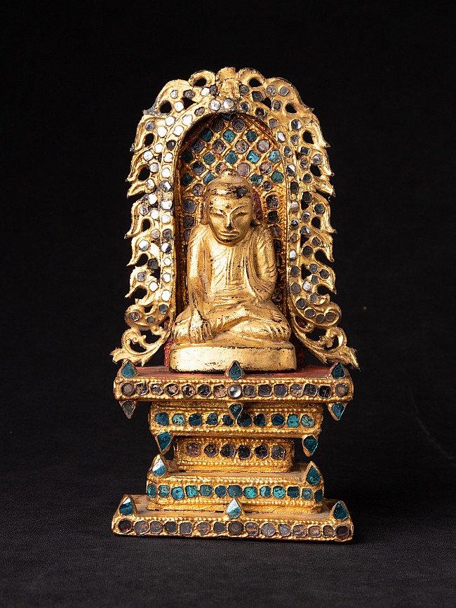 Antique Buddha statue on throne