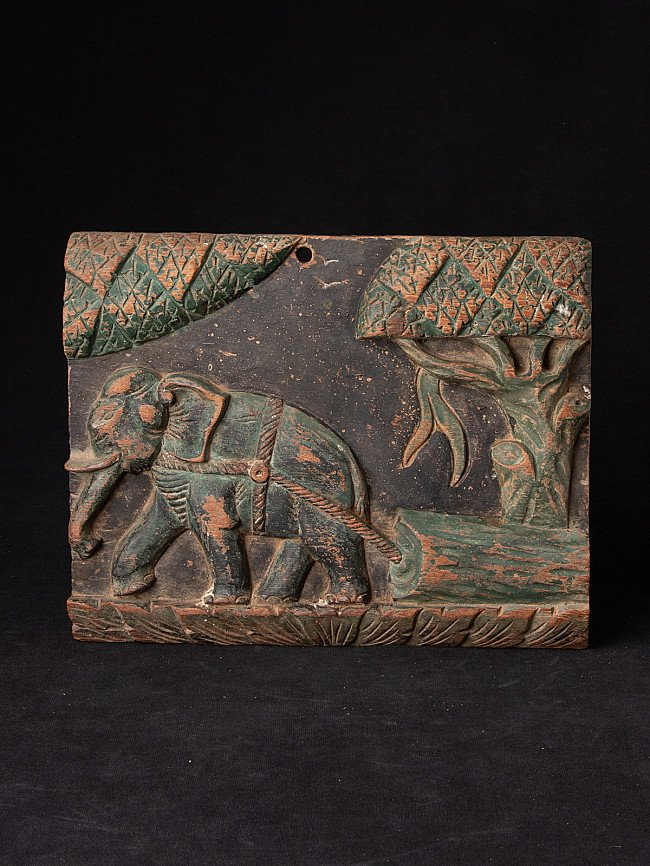 Antique wooden panel with elephant
