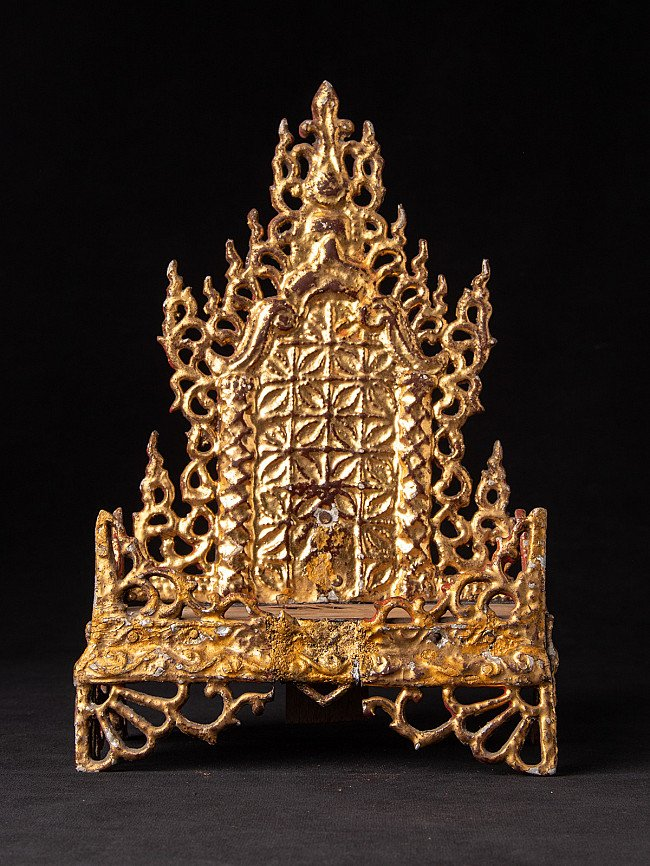 Old Buddhist shrine from wood and metal