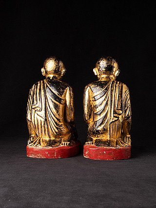 Antique pair of monk statues
