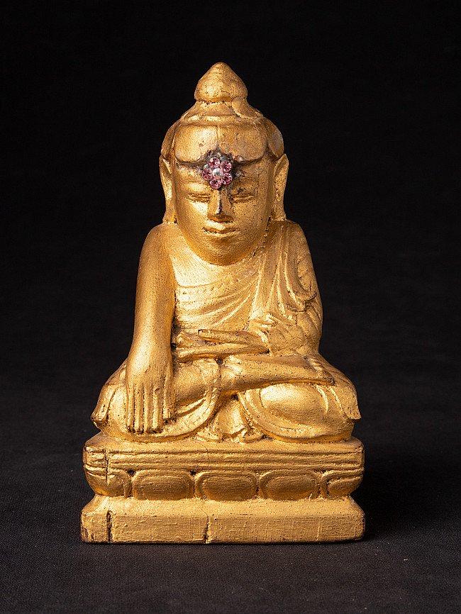 Antike holzerne Buddhafigur