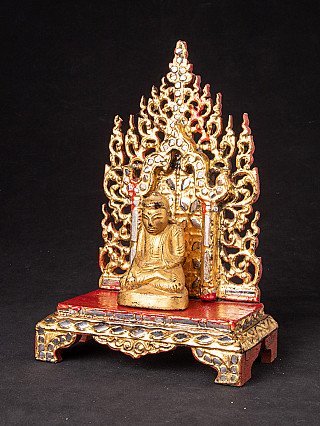 Antique throne with Buddha statue
