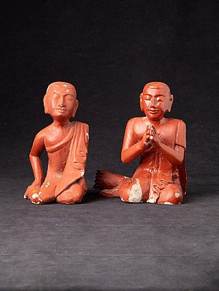 Old pair of monk statues