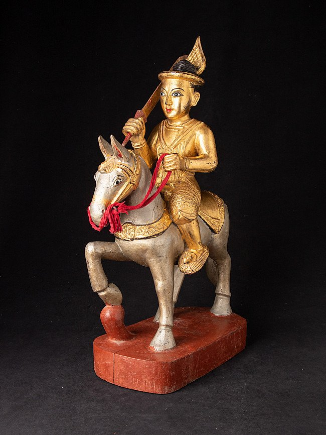Antique wooden Nat statue on horse
