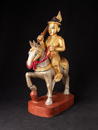 Antique wooden Nat statue on horse