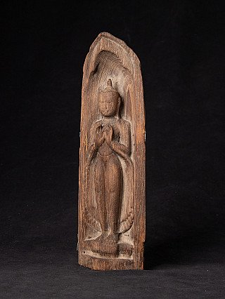 Old wooden standing Buddha