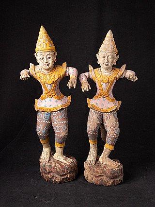 Pair of old dancing figures