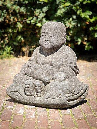 Lavastone monk statue