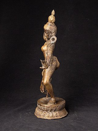 Old bronze dancing Dakini statue