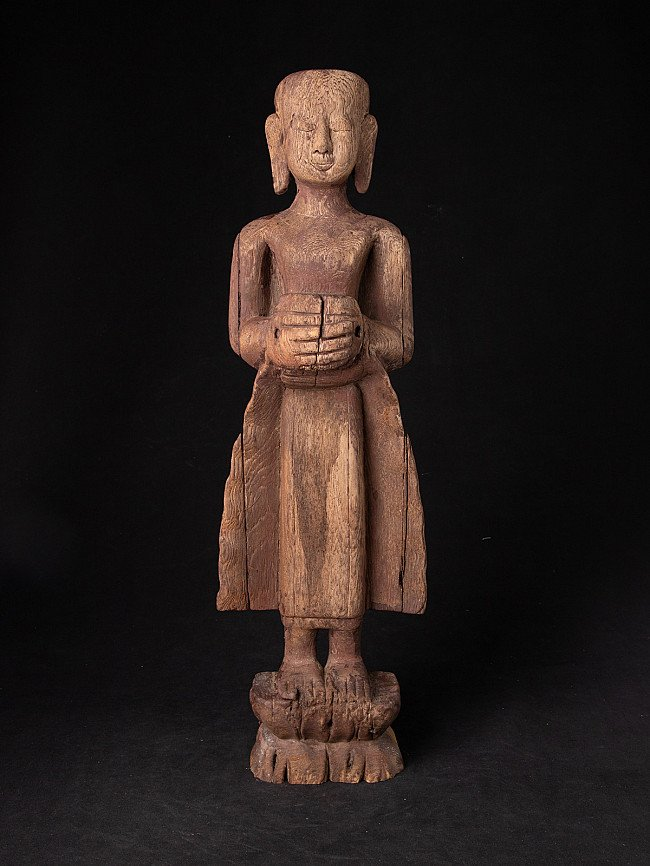 Antique standing monk statue