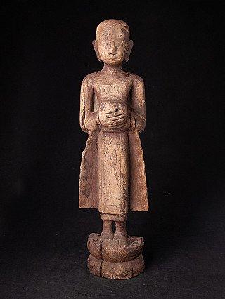Old wooden Burmese Monk