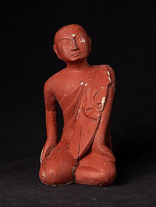 Old Burmese wooden monk statue