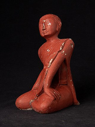 Old Burmese wooden monk statue