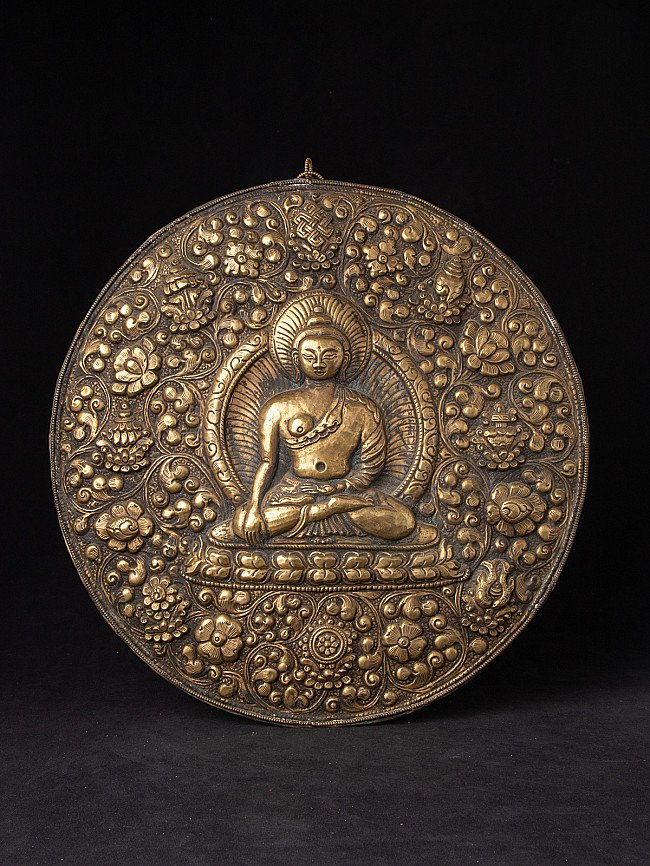 Old copper repousse Buddha panel