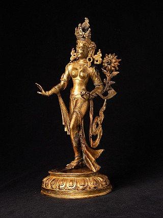Old bronze gilded Tara statue