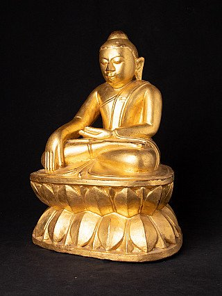 Antike holzerne Birmanische Buddhafigur