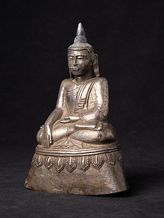 Antique silver Buddha statue