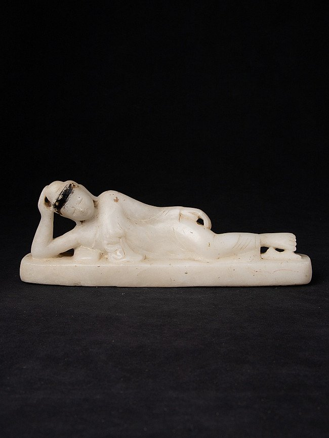 Antique marble reclining Buddha statue