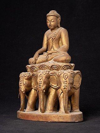 Old Burmese Buddha statue on elephant throne