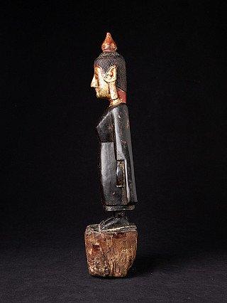 Antique wooden Tai Lue Buddha statue