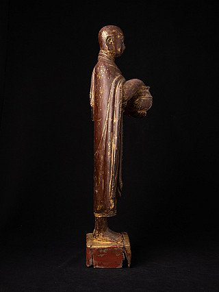 Antique standing Burmese Monk statue