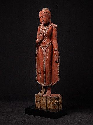 Antique standing Burmese Buddha statue