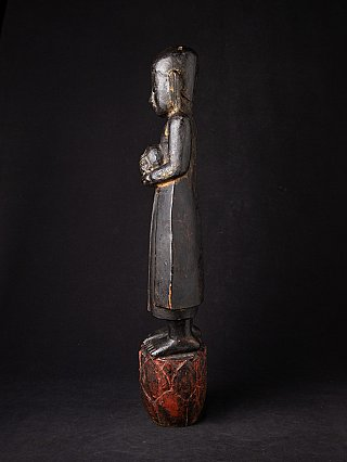 Antique wooden monk statue