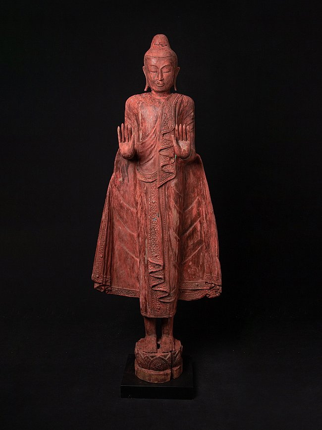 Large old wooden Buddha statue