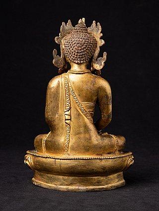 Old Nepali crowned Buddha statue