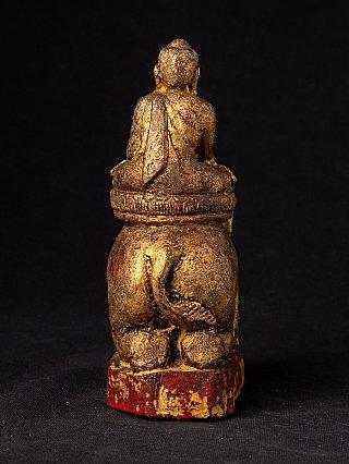 Antiek houten Boeddhabeeld op olifant